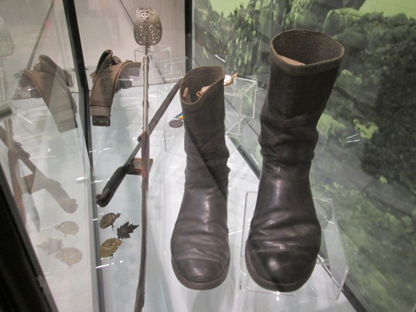 John Thompson's flying boots and gun belt on display for the Service and Sacrifice exhibit at Vaughan City Hall.