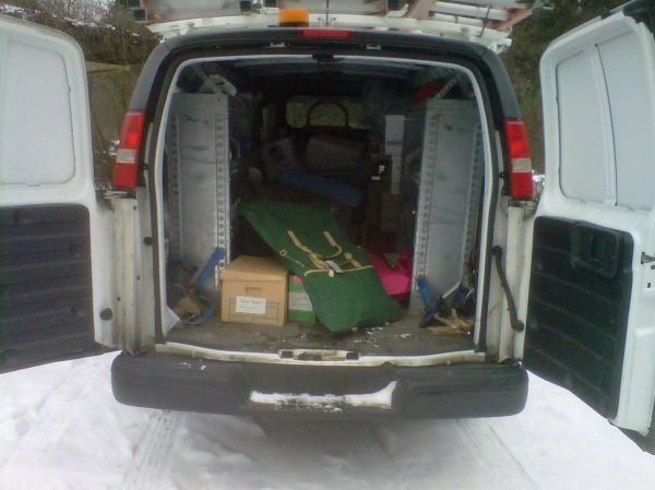 Loading the Berton records into a City van.