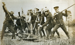 First World War soldiers pointing rifles and bayonets at Donald Ross Mackenzie