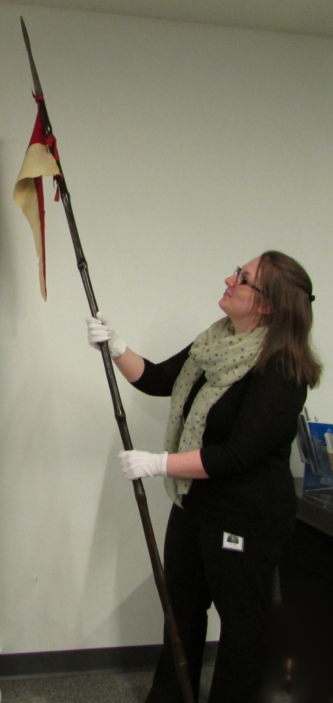 Archival records analyst Jill Shaw with Mackenzie's lance, ca. 1905
