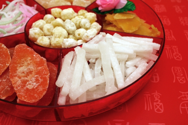 Assorted dried fruits, nuts and candies are served during the New Year.